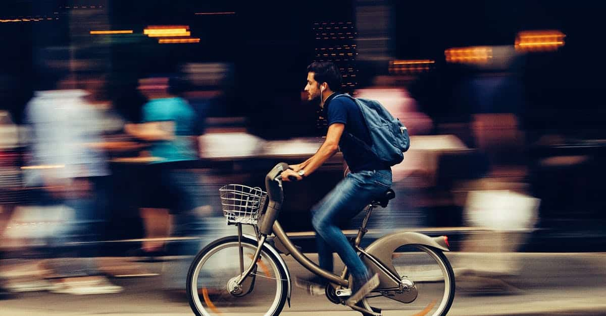 A person riding a bicycle on a city street