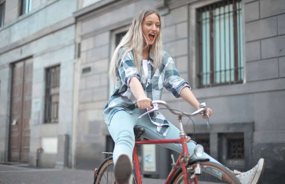 A woman riding on the back of a bicycle