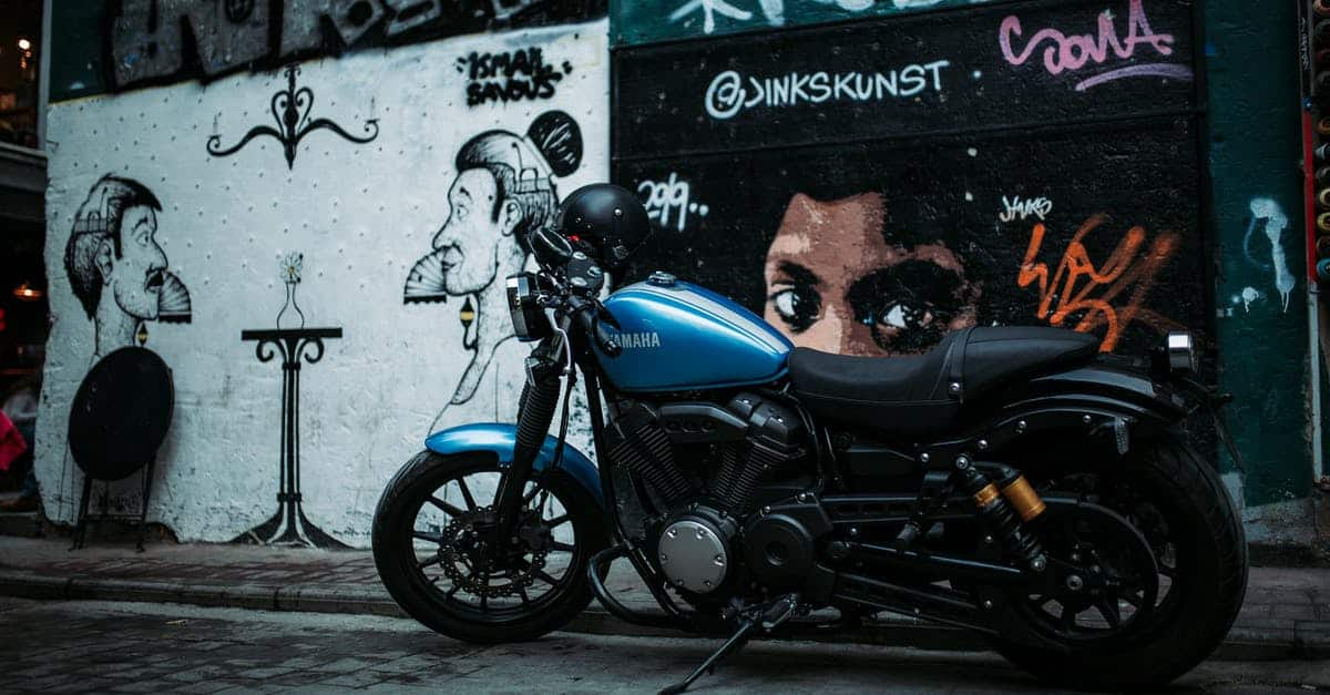 A motorcycle parked on the side of a building